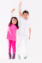 Happy kids smiling isolated over a white background Stock Photography