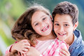 Happy kids smiling portrait of two outdoors Royalty Free Stock Photo