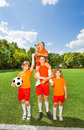 Happy kids with won cup stand in pyramid Royalty Free Stock Photo
