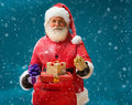 Happy and kind Santa Claus with christmas present Royalty Free Stock Photo
