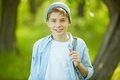 Happy lad portrait of cute in casual clothes looking at camera outside Stock Image