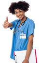 Happy lady doctor showing thumbs up sign Royalty Free Stock Photos