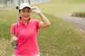 Happy lady golfer on the golf course Stock Photography