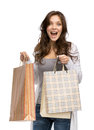 Happy lady with shopping bags half length portrait of isolated on white concept of consumerism and purchase Royalty Free Stock Image