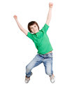 Happy laughing boy jumping on white isolated background