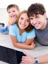 Happy laughing family with laptop Royalty Free Stock Photography