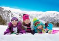 Happy laughing kids outside at winter three girls in the snow together with mountains behind Royalty Free Stock Photography