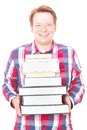 Happy learning front view young man holding a pile of books for your knowledge books reading education or information copy Stock Photo