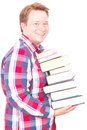 Happy learning side view young man holding a pile of books for your knowledge books reading education or information copy isolated Royalty Free Stock Photo