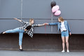 Happy lesbian couple holding hands with air balloons outdoors Royalty Free Stock Photo