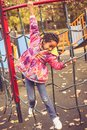 African American girl on playground. Royalty Free Stock Photo