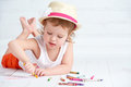 Happy little artist  girl in a hat draws pencil Royalty Free Stock Photo