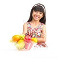 Happy little asian girl sitting on the table with plate of fruit isolated white Royalty Free Stock Photos