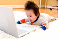 Happy little baby boy with a laptop Royalty Free Stock Photo