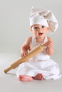 Happy little baby in a cook cap laughs cute Stock Photos