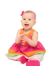 Happy little baby girl in bright multicolored festive dress isol isolated on a white background Royalty Free Stock Photo