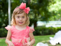 Happy little beautiful girl in pink dress Royalty Free Stock Photos
