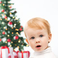 Happy little boy with christmas tree and gifts winter people x mas happiness concept Royalty Free Stock Image