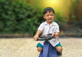 Happy little boy drive toy car.Playful kid at playground Royalty Free Stock Photo