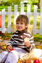 Happy little boy eating chocolate in the autumn forest Royalty Free Stock Image