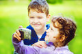 Happy little boy and girl taking self photo in the autumn park Royalty Free Stock Image
