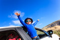 Happy little boy and girl travel by car in Royalty Free Stock Photo