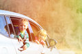 Happy little boy and girl travel by car in nature Royalty Free Stock Photo