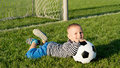 Happy little boy with his soccer ball Royalty Free Stock Photo