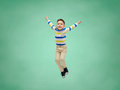 Happy little boy jumping in air over school board Royalty Free Stock Photo