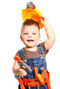 Happy little boy in an orange helmet and tools on a white backgr Royalty Free Stock Photo