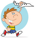 Happy little boy playing with airplane Stock Image