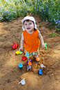Happy little boy playing with sand on playground Royalty Free Stock Photo