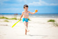 Happy little boy playing on tropical beach Royalty Free Stock Images