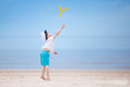 Happy little boy playing on tropical beach beautiful summer day Royalty Free Stock Images