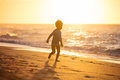 Happy little boy running on beach. Royalty Free Stock Photo