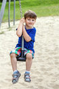 Happy little boy sit on swing rope outdoor activity Stock Photos
