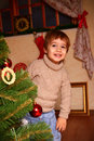 Happy little boy standing near the Christmas tree Royalty Free Stock Photo
