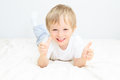 Happy little boy with thumbs up on white background Stock Photo