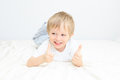 Happy little boy with thumbs up on white background Royalty Free Stock Images