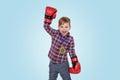 Happy little boy wearing boxing glovesa and celebrating success Royalty Free Stock Photo