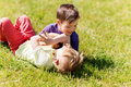 Happy little boys fighting for fun on grass Royalty Free Stock Photo