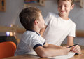 Happy little boys solve math problem smile brother helps Stock Image