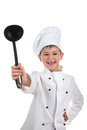 Happy little chef showing his black ladle on white background. Royalty Free Stock Photo
