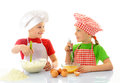 Happy little chefs preparing dough kids with chef hats tha cake Stock Photos