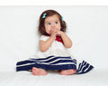 Happy little child girl sit on white towel, happy emotion and face expression, very surprised, the finger in mouth Royalty Free Stock Photo