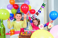 Happy little children are having fun in a birthday party Stock Images