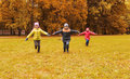 Happy little children running and playing outdoors Royalty Free Stock Photo