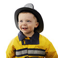 Happy little fireman close up portrait of an adorable year old in his s outfit on a white background Royalty Free Stock Image