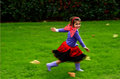 Happy little girl age dressed up as lady bug play pretend to fly runs in the garden outdoor photo with copyspace Stock Photography