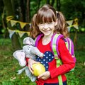 Happy little girl with a backpack. Square. The concept is back t Royalty Free Stock Photo